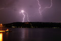 Lightning strike on akrotiri a violent thunder and storm lashes the peninsula near chania crete seen from souda port Royalty Free Stock Image
