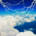 Lightning strike in blue sky with clouds Stock Photo