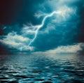 Lightning strike on the dark cloudy sky Royalty Free Stock Photo