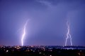 Lightning strike over dark blue sky in night city Royalty Free Stock Photo