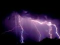 Lightning strike rain storm with a near the colorado mountain range Royalty Free Stock Images