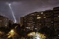 Lightning strike real bolt in city during a storm Royalty Free Stock Image