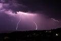 Lightning strikes over the sea surface night storm on black town of balchik in bulgaria Stock Photo