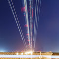 Lights of aircraft on the glide path during night landings Stock Photos