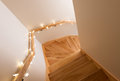 Lights decorating wooden staircase Royalty Free Stock Photo