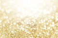Lights on gold with star bokeh background. Royalty Free Stock Photo