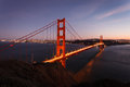 Lights illuminate the golden gate bridge at twilight san francisco and city skyline in aerial view from north side cliffs Stock Images