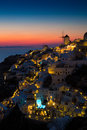 Lights of Oia village at night, Santorini, Greece. Royalty Free Stock Photo