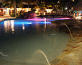 Lights reflected over a resort pool, Caribbean Royalty Free Stock Photography