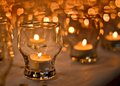 Lights religious celebration with candle in glass cups Royalty Free Stock Photography