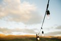 Lights on a string hanging outdoors Royalty Free Stock Photos