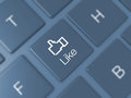 Like key on keyboard and icon blue blurry Royalty Free Stock Images