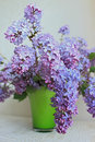 Lilac bouquet in green vase
