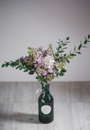 Lilac Flower In A Green Vase O...