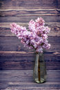 Lilac flowers in vase. Style nostalgia