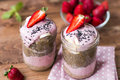 Lilac smoothie  with strawberry,  baтanas and chia pudding in two jars on wooden background Royalty Free Stock Photo