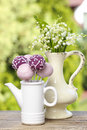 Lilly of the valley flowers and pastel cake pops on wooden table in summer garden Stock Photography