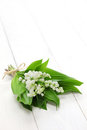 Lily of the valley posy isolated on white wooden background Stock Images