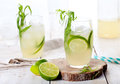 Lime cucumber lemonade cocktail on a white table Royalty Free Stock Photo