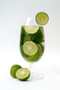 Lime drink beverage a rounded citrus fruit similar to a lemon but greener smaller and with a distinctive acid flavor Stock Photo