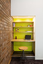 Lime green feature wall study nook in living room Royalty Free Stock Photo