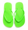Lime green flipflops on a white background pair of Stock Photography
