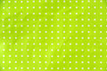 Lime green paper with white dots as background Royalty Free Stock Photo