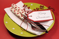 Lime green and red Merry Christmas table place setting.
