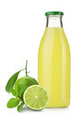 Lime juice bottle, ripe limes and mint Royalty Free Stock Photography
