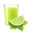 Lime juice glass of and mint over white background Royalty Free Stock Photos