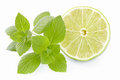 Lime limes with a mint branch on the isolated white background Stock Photo