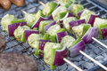 Lime mint coriander chicken kebabs with red onion and green peppers on a skewer being cooked on a portable bbq burgers and Stock Photos