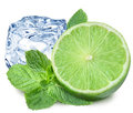 Lime, mint and ice cube on a white background Royalty Free Stock Photo