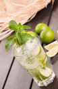 Lime moijto cocktail with straw hat on a deck mojito cuban made cuban rum sugar and splash of soda Royalty Free Stock Photos