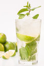 Lime mojito cocktail with limes background a cuban made cuban rum sugar and a splash of soda Royalty Free Stock Photo