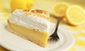 Lime pie fresh and delicious with fork and lemon in background Royalty Free Stock Image