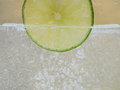 Lime piece of in the water Royalty Free Stock Photo