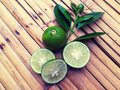 stock image of  Lime slice on bamboo table