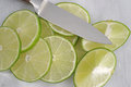 Lime slices on cutting board with a knife Royalty Free Stock Photo