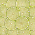 Lime slices green background with citrus fruit of Stock Images