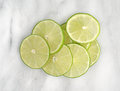 Lime slices on a marble cutting board Royalty Free Stock Photo