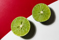 Lime split in half on a table Royalty Free Stock Images