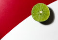 Lime split in half on a table Stock Photo