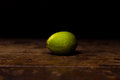 Lime on wooden surface a Royalty Free Stock Photos