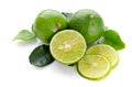 Limes with lime slices and leaves isolated on white background Royalty Free Stock Images