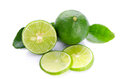 Limes with lime slices and leaves isolated on white background Royalty Free Stock Photos