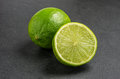 Limes on slate plate Stock Image
