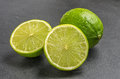 Limes on slate plate Royalty Free Stock Photography