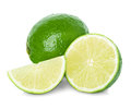 Limes with slices isolated on white Stock Images
