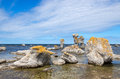 Limestone formations on the swedish coastline fårö island in gotland sweden these rocks are called raukar in Royalty Free Stock Photos